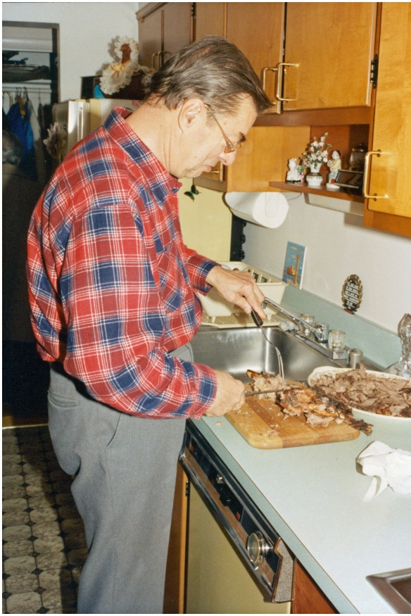 Andrew Kostakos carving Easter lamb, 1992.
